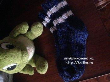 Вязаные спицами носки - работа Ольги