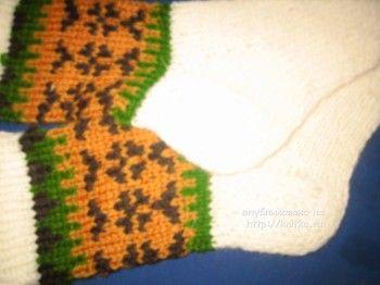 Вязаные спицами носки - работа Gunta Minalgo