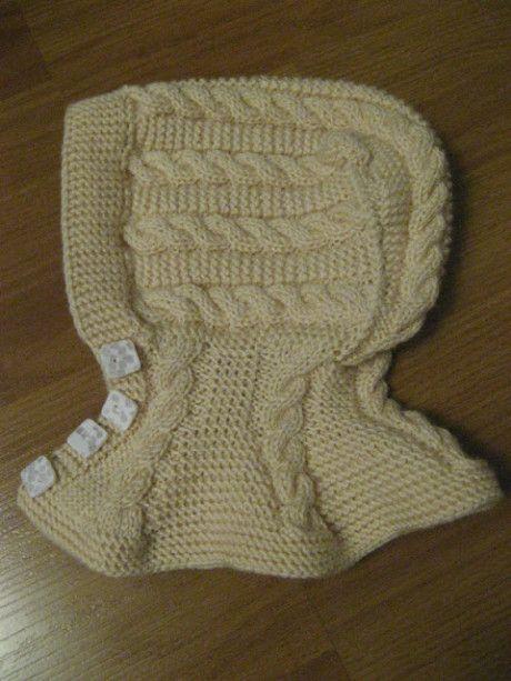 Шапочка - шлем с косами для девочки, связана спицами
