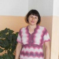 Вязаное спицами платье - работа Наталии Гуторовой