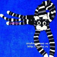 Кото – шарф, связанный спицами