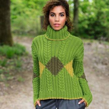 Красивый женский свитер спицами с высоким горлом и косами